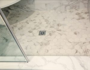 Conway Builders Marble Tile Shower with accent